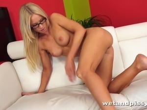 Pretty blonde in glasses uses a jelly dildo on her wet