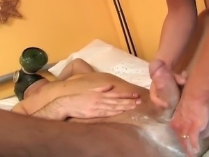 Beautiful slave girl oiling and massaging a masters massive cock