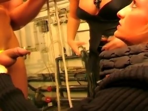 Two blonde mistresses humiliating and torturing their handsome slave