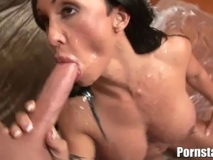 Sultry and alluring busty brunette pornstar named Jewels Jade gets to take on...
