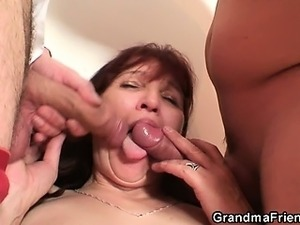 Poker playing granny swallowing two big cocks