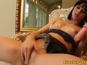 Hot solo babe rubbing her pussy with a big toy while bored at home