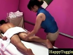Asian masseur gives a sensual massage