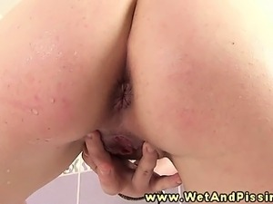 Pissing wam babe sprays piss on herself