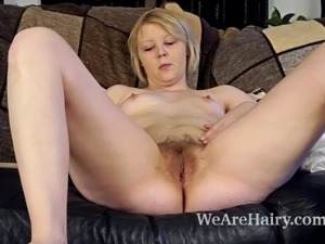 Danniella is a sexy blonde beauty laying on the couch when she starts...