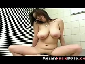 Sexy Asian wife giving her husband a tits job