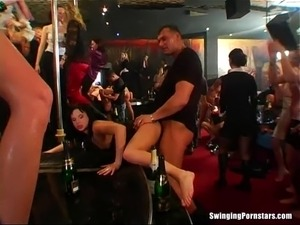 Horny club bitches suck and ride fat cocks in public