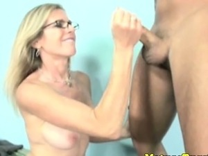Handjob loving milf with spex tugs cock