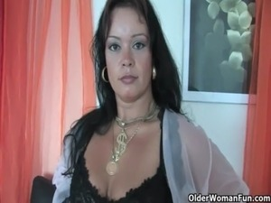 Chubby soccer mom in stockings works her hard clit free
