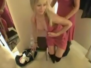 Two super hot blondes fucking with a strap-on in a changing room free