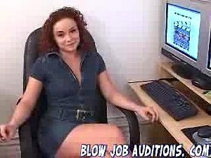 Redhead Julia gives a blowjob, ends with facial.