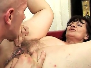 Old bitch Helena May fucks with strong guy! He stimulates her old hairy cunt...