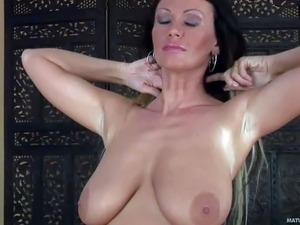 Mature temptress Pandora is proud of her big natural boobs