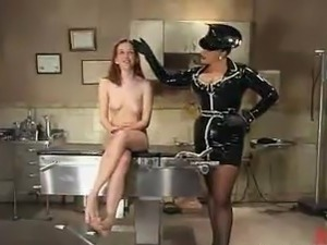 Betka Schpitz has Her Coochie Toyed By the Latex Dominatrix Smokie Flame