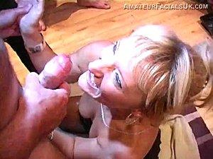 Cum slut Bonny gobbles drink and laps up strangers spunk.