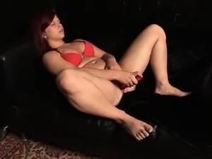 Cute Cora fucks her big red dildo to climax