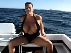 Busty woman masturbating about the vessel