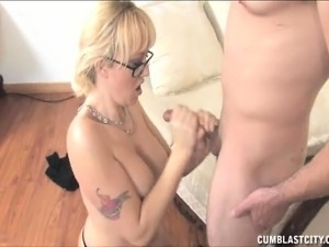 Alana's skillful hands slowly drive a hung stud's hard dick to orgasm