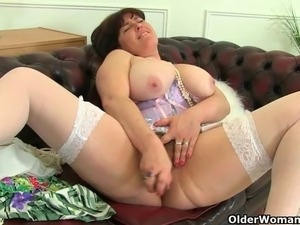 UK milfs Janey and Jayne Storm wears stockings with suspenders and work their...