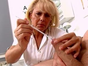 Mature Blonde Nurse measures patients penis soft and erect