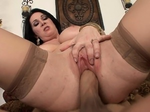 Stacked brunette cougar Rayveness fucks a large dick with excitement