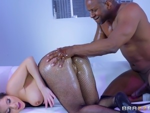 Black guy penetrates the oiled white chick with his big dick
