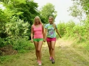 Two best girlfriends get horny and start to cuddle each other outdoor