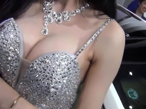 Sexy Asian babe with nice big tits is teasing those around