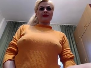 Sultry blonde flashes her big natural boobs and pleases her