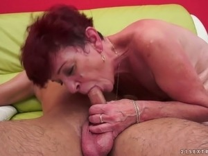 Redhead granny is screwed missionary style in dirty young and old fuck video