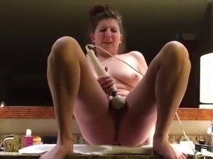 Hitachi wand makes her squirt for distance in the bathroom