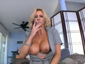 Busty blonde mom gives a blowjob and makes the guy suck a strapon