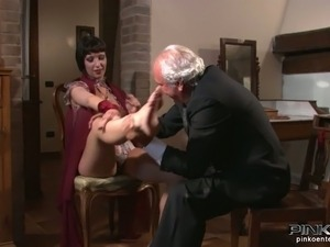 Old man worships gorgeous legs of busty brunette bombshell