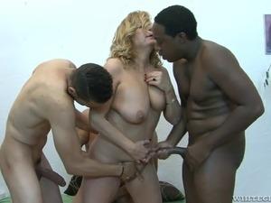 Interracial gangbang of a chubby mature blonde slut