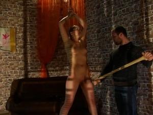 Pretty brunette tortured by cruel Master.