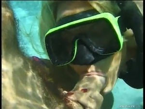 Slim blonde in a diving mask gives a blowjob in the sea