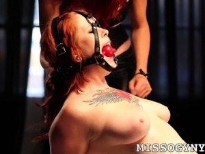 Tattooed redhead Misti Dawn gets tied up and enjoys intense orgasms