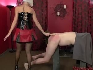 Nordic blonde Femdom Mistress whips big male slave