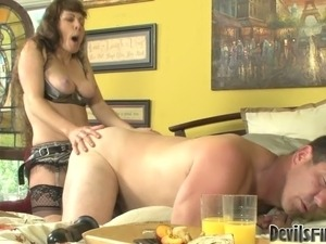Brunette harlot Alexandra Silk fucks Paul Carrigan with a strap on