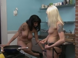 True lesbian lovers playing with strapon