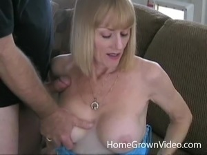 Busty milf takes on two throbbing dongs and makes them cum