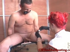 Fishnet-clad redhead with a beautiful tattooed body torturing a stranger