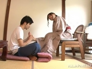 Beddable Japanese dame enjoys  double pleasure riding on a huge penis with...