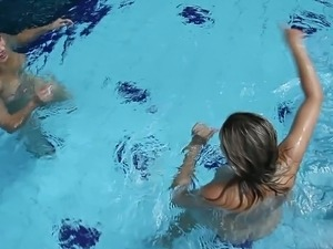 Two sexy slim girls swimming naked in the pool giving quiet the show