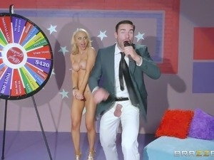On a game show she wins the prize of a nice, hard cock