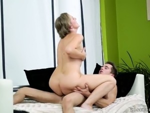 Small breasted mature blondie asked young man to pound her kitty in various...