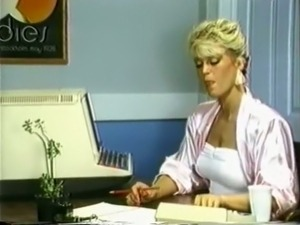 Wicked and hot blonde woman in the office teases her colleague