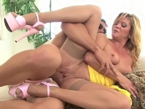 Blonde mature milf in stockings and heels fucks youger guy