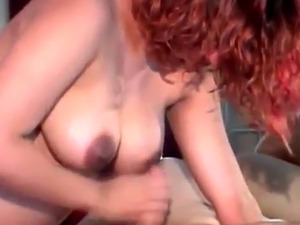 Redhead pregnant babe with big tits blowing stiff cock