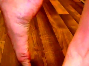 Solo tgirl barefoot in the kitchen